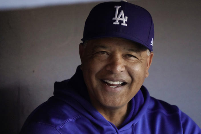 Los Angeles Dodgers manager Dave Roberts sits in the dugout during batting practice before Game 4 of the baseball team's National League Division Series against the San Francisco Giants, Tuesday, Oct. 12, 2021, in Los Angeles. (AP Photo/Marcio Jose Sanchez)