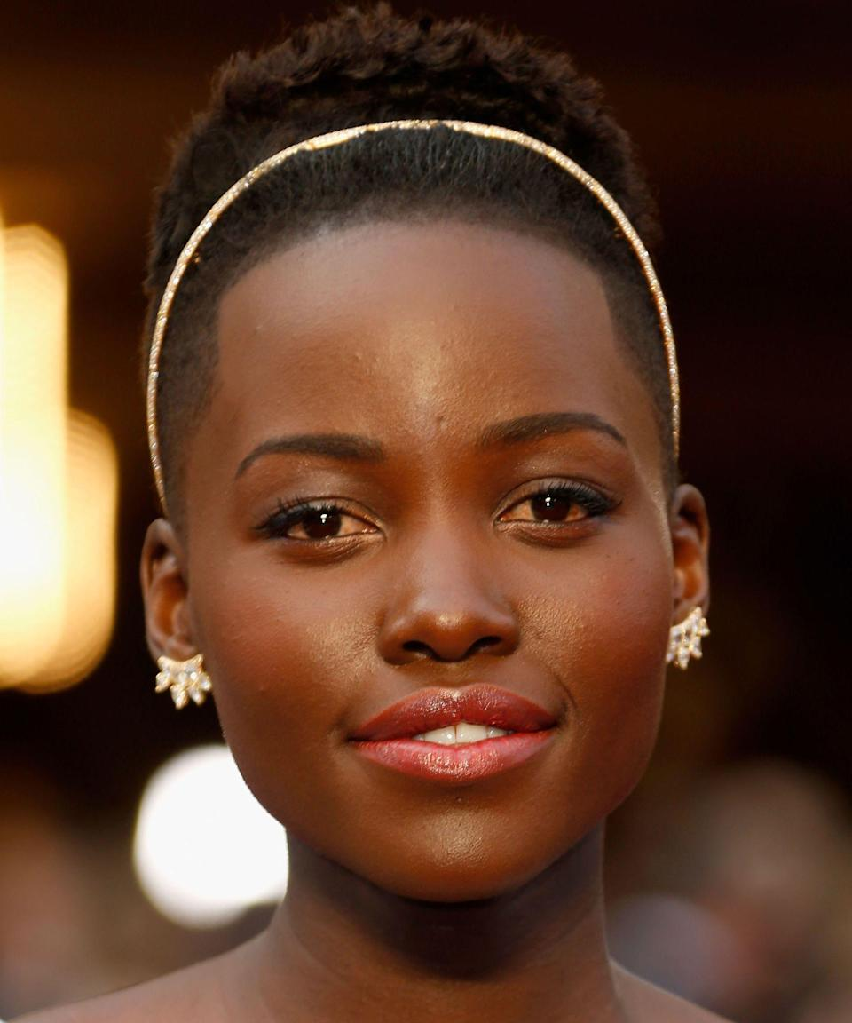"""<p><strong>Lupita Nyong'o, 2014</strong></p><p>We remember Lupita's first red carpet season like it was yesterday. A standout among so many noteworthy looks from her debut? This Oscars moment, in which she arrived like a princess wearing the most sparkling of Fred Leighton headbands — something that made us run out to <u><a href=""""https://www.refinery29.com/en-us/2014/03/63636/lupita-nyongo-oscars-headband"""" rel=""""nofollow noopener"""" target=""""_blank"""" data-ylk=""""slk:cop our own"""" class=""""link rapid-noclick-resp"""">cop our own</a></u> (well, give or take a few figures).</p><span class=""""copyright"""">Photo: Jeff Vespa/WireImage.</span>"""