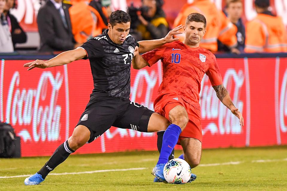 Sep 6, 2019; East Rutherford, NJ, USA; Mexico defender Jorge Sanchez (21) and United States midfielder Christian Pulisic (10) battle for a ball during the first half of an international friendly soccer match at MetLife Stadium. Mandatory Credit: Dennis Schneidler-USA TODAY Sports