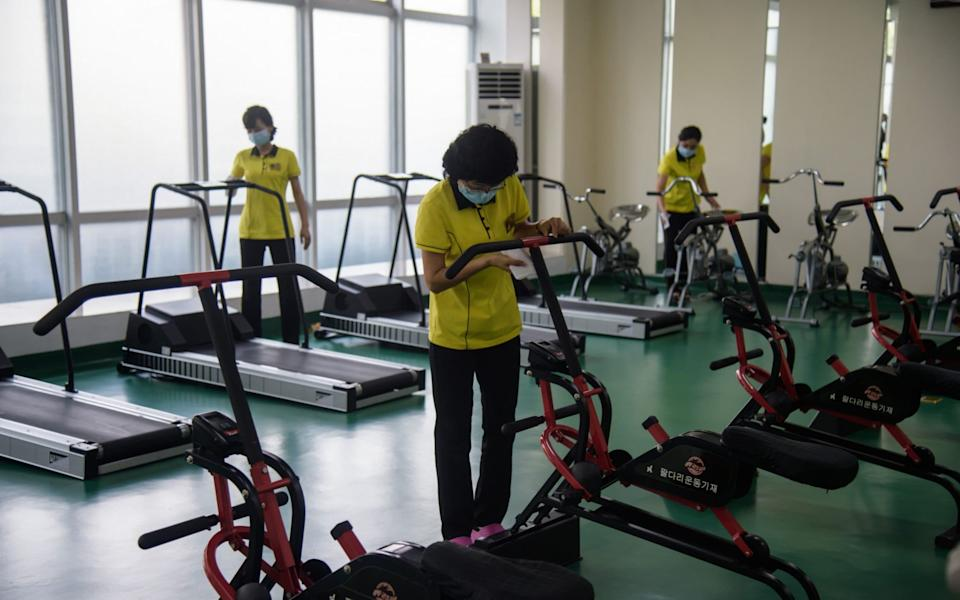 Staff disinfect gym equipment at the Ryugyong Health Complex in Pyongyang - Kim Won Jin/AFP