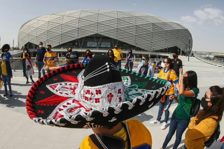 A sombrero-wearing fan of Mexico's Tigres football club stands outside Education City Stadium in the Qatari city of Ar-Rayyan on January 30, 2021 , clad in masks due to the COVID-19 coronavirus pandemic and wearing sombreros, gather to support their team at an event for fans outside Education City Stadium in the Qatari city of Ar-Rayyan on January 30, 2021, ahead of their match against Ulsan Hyundai FC the following week.