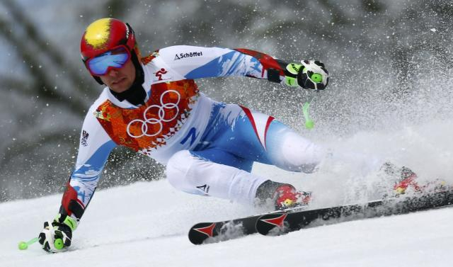 Austria's Marcel Hirscher skis during the first run of the men's alpine skiing giant slalom event at the 2014 Sochi Winter Olympics at the Rosa Khutor Alpine Center February 19, 2014. REUTERS/Dominic Ebenbichler (RUSSIA - Tags: SPORT SKIING OLYMPICS)