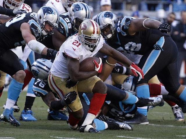 San Francisco 49ers running back Frank Gore (21) runs against the Carolina Panthers during the second half of a divisional playoff NFL football game, Sunday, Jan. 12, 2014, in Charlotte, N.C. (AP Photo/John Bazemore)