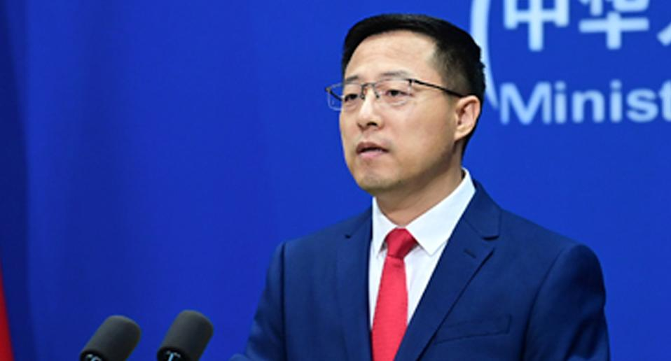 China's Foreign Ministry spokesperson Zhao Lijian in a blue suit and red tie.