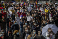 Demonstrators gather during a protest to demand more resources for public health system in Madrid, Spain, Sunday, Nov. 29, 2020. The organizers delivered a manifesto to the Madrid regional authorities demanding the end privatization of the health system. (AP Photo/Bernat Armangue)