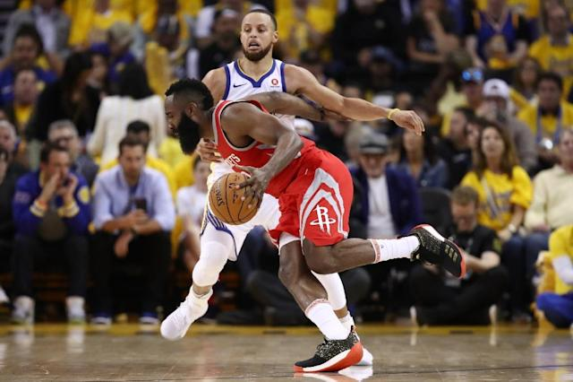 James Harden of the Houston Rockets drives against Stephen Curry of the Golden State Warriors during game three of the Western Conference Finals (AFP Photo/EZRA SHAW)
