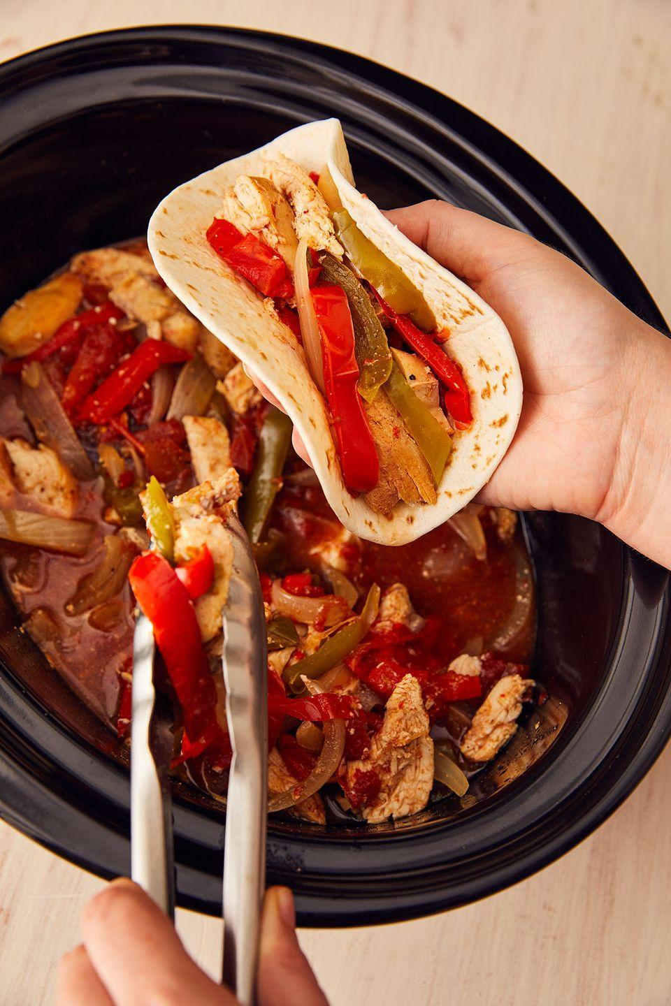 """<p>Prep it before work and come home to the best-smelling kitchen. </p><p>Get the recipe from <a href=""""https://www.delish.com/cooking/recipe-ideas/a22175263/crockpot-chicken-fajitas-recipe/"""" rel=""""nofollow noopener"""" target=""""_blank"""" data-ylk=""""slk:Delish"""" class=""""link rapid-noclick-resp"""">Delish</a>.</p>"""