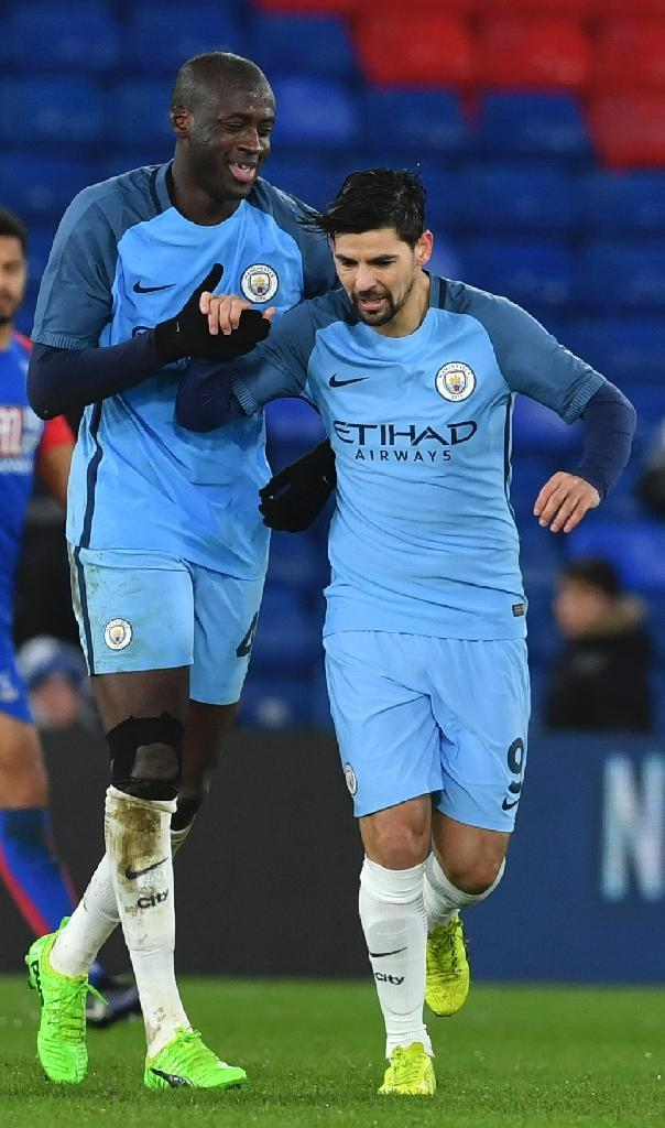 Manchester City's midfielder Yaya Toure (L) celebrates scoring their third goal with midfielder Nolito (R) during the English FA Cup fourth round football match against Crystal Palace January 28, 2017 (AFP Photo/Ben STANSALL)