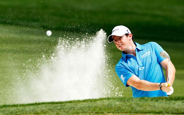 CHARLOTTE, NC - MAY 06: Rory McIlroy of Northern Ireland hits a shot from a greenside bunker on the sixth hole during the final round of the Wells Fargo Championship at the Quail Hollow Club on May 6, 2012 in Charlotte, North Carolina. (Photo by Mike Ehrmann/Getty Images)