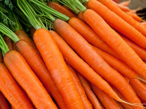 """<div class=""""caption-credit""""> Photo by: COURTESY OF GETTY IMAGES</div><div class=""""caption-title"""">Carrots</div>Stock up on orange colored foods-like carrots or squash-to clear up blemish-prone skin. These beta-carotene rich foods actually convert to vitamin A in the body. This process iincreases oil production in the skin's sebaceous glands, helping with conditions like acne."""