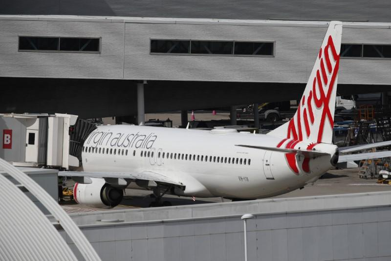 Virgin Australia plans to cut more domestic flights as travel restrictions tighten