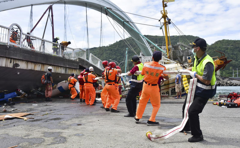 Rescue workers trying to free people trapped under the collapsed bridge in Taiwan.