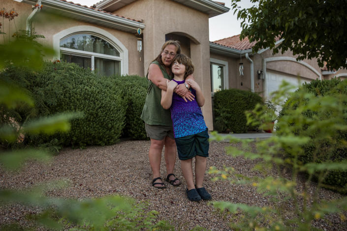 Rebecca Mallery, who is applying for subsidized housing for herself, and her 9-year-old son, Chord Pagel, outside her home in Bullhead City, Ariz. on July 28, 2020. (Joe Buglewicz/The New York Times)