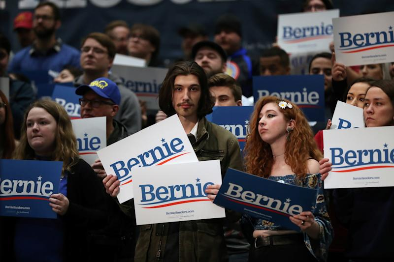 Attendees hold signs during a campaign rally held by Democratic 2020 U.S. presidential candidate and U.S. Senator Bernie Sanders (I-VT) in Sioux City, Iowa, U.S., January 26, 2020. REUTERS/Ivan Alvarado