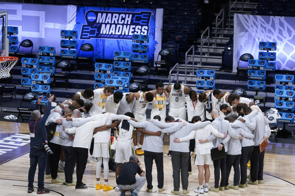 The Baylor team huddles in a circle after beating Villanova 62-51 in a Sweet 16 game in the NCAA men's college basketball tournament at Hinkle Fieldhouse in Indianapolis, Saturday, March 27, 2021. (AP Photo/Michael Conroy)