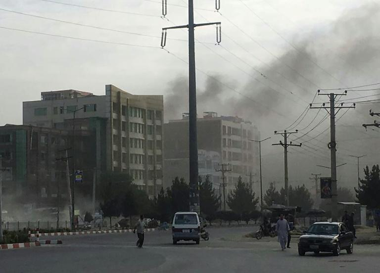 Smoke rises in Kabul from the site of an attack targeting the office of Afghan President Ashraf Ghani's running mate