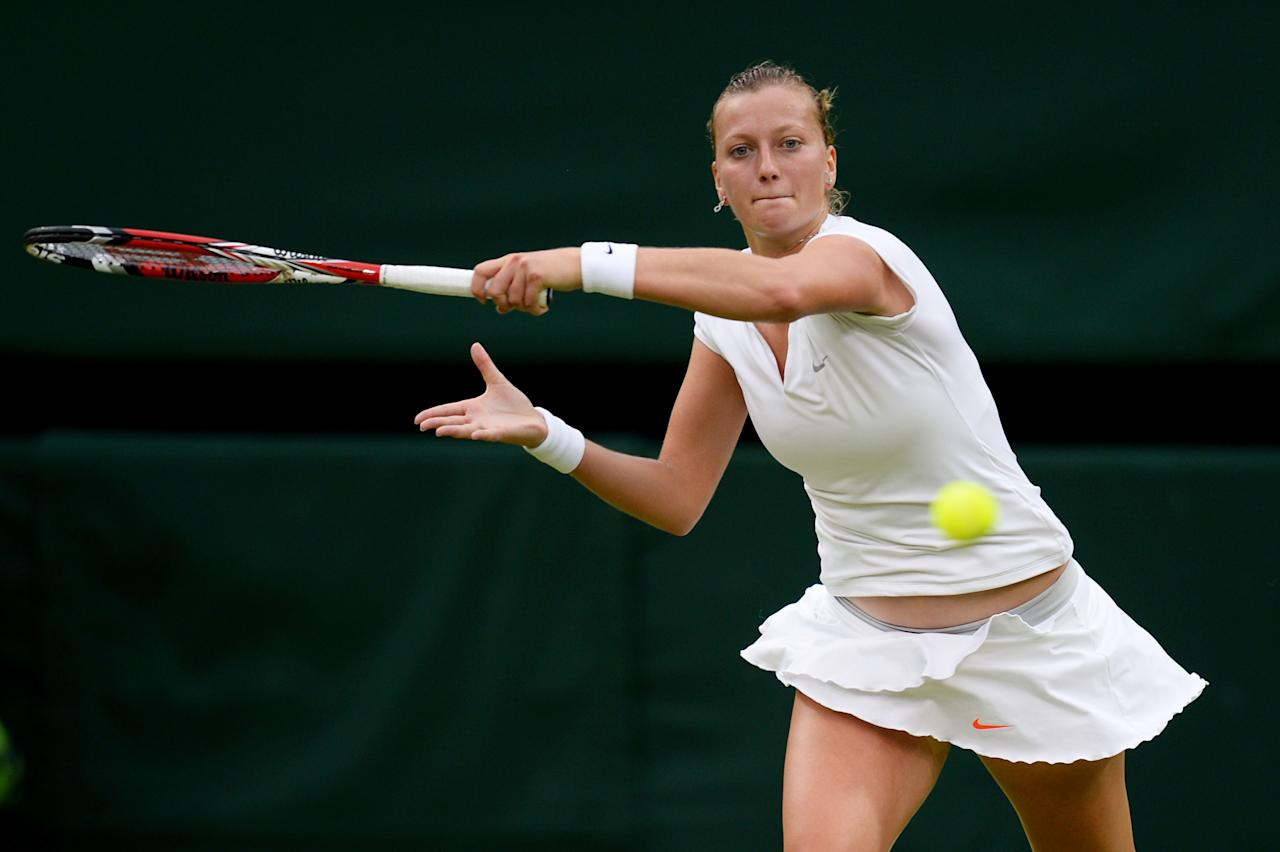 LONDON, ENGLAND - JULY 02: Petra Kvitova of Czech Republic plays a backhand during the Ladies' Singles quarter-final match against Kirsten Flipkens of Belgium on day eight of the Wimbledon Lawn Tennis Championships at the All England Lawn Tennis and Croquet Club at Wimbledon on July 2, 2013 in London, England. (Photo by Mike Hewitt/Getty Images)