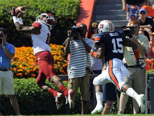 Arkansas receiver Javortee Herndon catches a touchdown against Auburn defender Joshua Holsey during the second half of an NCAA college football game, Saturday, Oct. 6, 2012 in Auburn, Ala. Arkansas won 24-7.(AP Photo/Todd J. Van Emst)