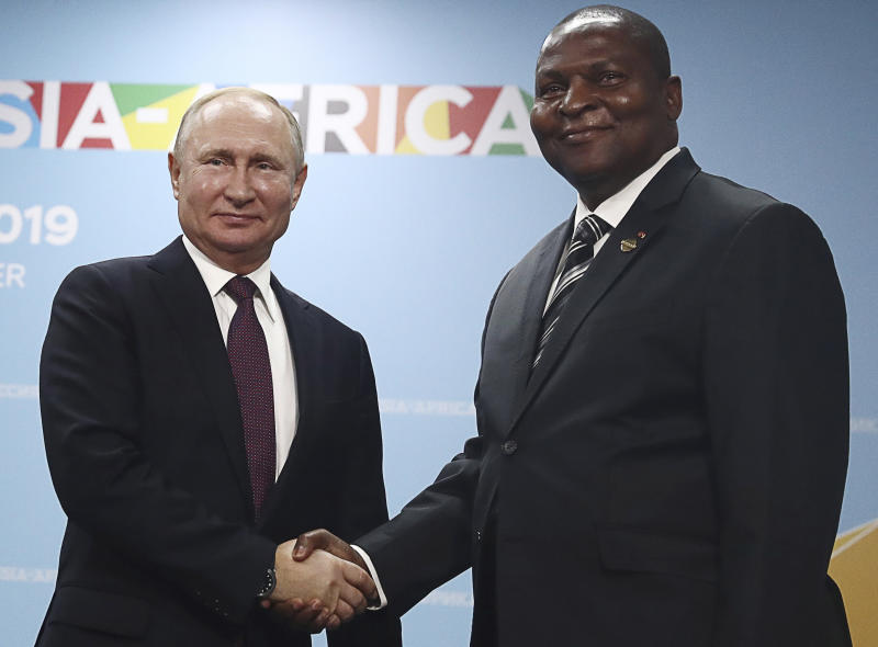 Russian President Vladimir Putin, left, and President of the Central African Republic Faustin Archange Touadera pose for a photo during their meeting on the sideline of Russia-Africa summit in the Black Sea resort of Sochi, Russia, Wednesday, Oct. 23, 2019. (Sergei Fadeyechev, TASS News Agency Pool Photo via AP)