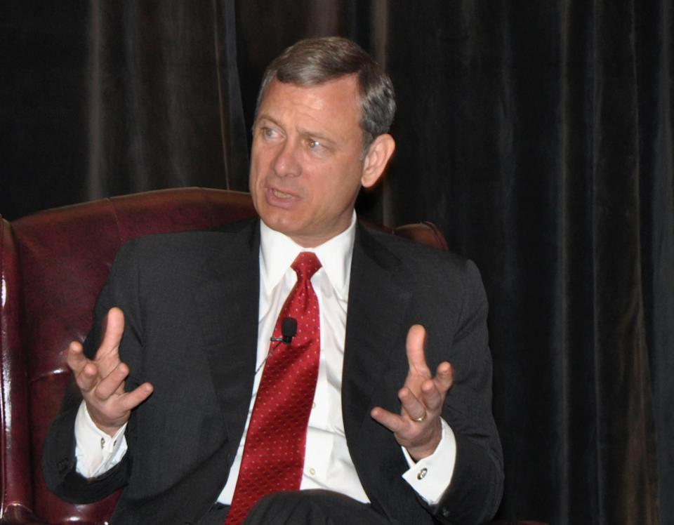 FILE - In this June 29, 2012 file photo provided by the U.S. Courts Circuit Executive's Office, Chief Justice John Roberts speaks in Farmington, Pa. When the U.S. Supreme Court gutted the Voting Rights act last week, it handed Republicans tough questions with no easy answers over how, and where, to attract voters even GOP leaders say the party needs to stay nationally competitive. The decision caught Republicans between newfound state autonomy that conservatives covet and the law's popularity among minority, young and poor voters who tend to align with Democrats. It's those voters that Republicans are eyeing to expand and invigorate the GOP's core of older, white Americans. (AP Photo/Ann Wilkins/US Courts Circuit Executive's Office, File)
