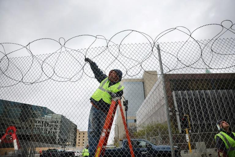 Workers fortify government buildings in downtown Minneapolis, Minnesota