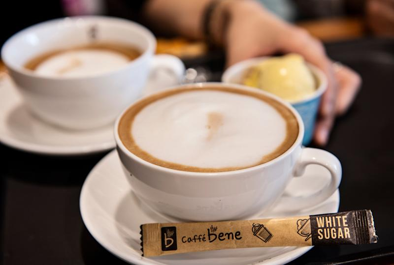 ULAANBAATAR, MONGOLIA - 2018/09/29: Customers enjoy a cappuccino (front), a espresso (back) and ice cream at the largest Korean coffeehouse chain, Caffe Bene. (Photo by Miguel Candela/SOPA Images/LightRocket via Getty Images)