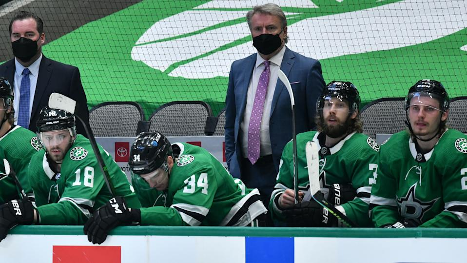 DALLAS, TX - MARCH 25: Rick Bowness of the Dallas Stars watches the action from behind the bench against the Tampa Bay Lightning at the American Airlines Center on March 25, 2021 in Dallas, Texas. (Photo by Glenn James/NHLI via Getty Images)