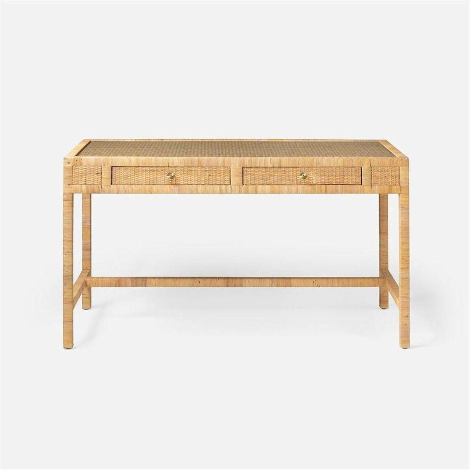"""<p>stephaniecohenhome.com</p><p><strong>$2800.00</strong></p><p><a href=""""https://stephaniecohenhome.com/products/made-goods-isla-rattan-desk-furisladk5424nt?currency=USD&variant=37183638307013&gclid=Cj0KCQjwwLKFBhDPARIsAPzPi-J7egUm_HxkyjsEaugXVentpUwQ1Le1F1P2h1do6tJw7QlxZas10ysaAtWvEALw_wcB"""" rel=""""nofollow noopener"""" target=""""_blank"""" data-ylk=""""slk:Shop Now"""" class=""""link rapid-noclick-resp"""">Shop Now</a></p><p>Clean lines make this <a href=""""https://stephaniecohenhome.com/"""" rel=""""nofollow noopener"""" target=""""_blank"""" data-ylk=""""slk:Made Goods"""" class=""""link rapid-noclick-resp"""">Made Goods</a> rattan desk a stand out. Every detail has been thought out, from the tempered glass protecting the top to the soft-close drawers.</p>"""