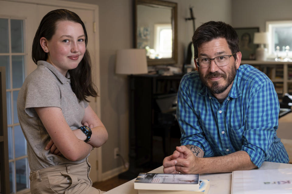Jay Wamsted, right, and his daughter, Kira, are photographed on Thursday, May 20, 2021 in Smyrna, Ga. Wamsted, who is an 8th grade math teacher allowed his daughter to skip testing this year. With new flexibility from the Biden administration, states are adopting a patchwork of testing plans that aim to curb the stress of exams while still capturing some data on student learning. (AP Photo/Ben Gray)