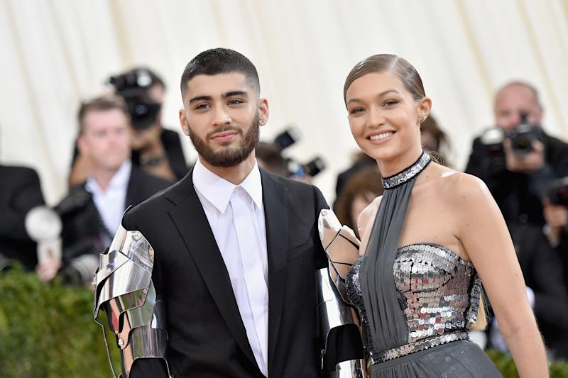 Zayn Malik and Gigi Hadid at an awards event looking amazing in black suit and grey shiny dress.