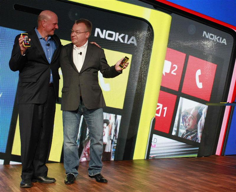File photo shows Microsoft CEO Ballmer and his Nokia counterpart Elop introducing new Nokia phones with Microsoft's Windows 8 operating system in New York