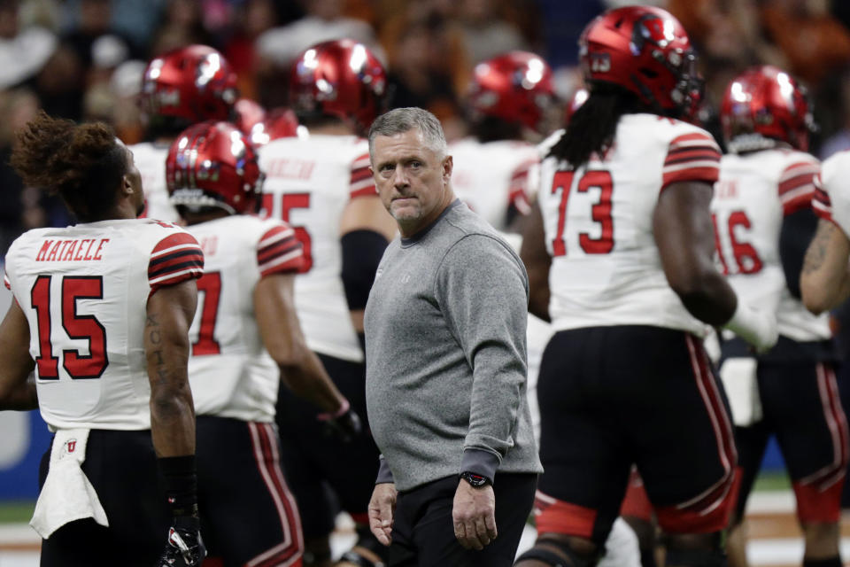 FILE - In this Dec. 31, 2019, file photo, Utah head coach Kyle Whittingham, center, watches over his team as they prepare for the Alamo Bowl NCAA college football game against Texas in San Antonio. The season opener scheduled for Saturday between Utah and Arizona in Salt Lake City was canceled following a request from the Utes due to what the Pac-12 said were a number of COVID-19 cases among Utah players. (AP Photo/Eric Gay, File)