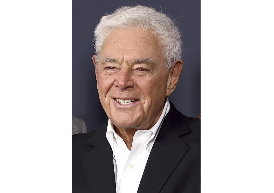 """FILE - Richard Donner arrives at a tribute event in his honor on June 7, 2017, in Beverly Hills, Calif. The filmmaker, who helped create the modern superhero blockbuster with 1978's """"Superman"""" and mastered the buddy comedy with the """"Lethal Weapon"""" franchise, has died. He was 91. Lauren Shuler Donner, his wife and producing partner, told the Hollywood trade """"Deadline"""" that Donner died Monday, July 5, 2021. (Photo by Jordan Strauss/Invision/AP, File)"""