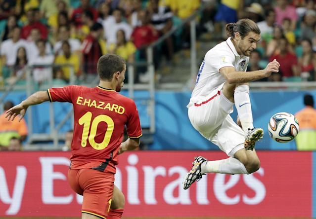 United States' Graham Zusi, right, controls the ball next to Belgium's Eden Hazard (10) during the World Cup round of 16 soccer match between Belgium and the USA at the Arena Fonte Nova in Salvador, Brazil, Tuesday, July 1, 2014. (AP Photo/Felipe Dana)