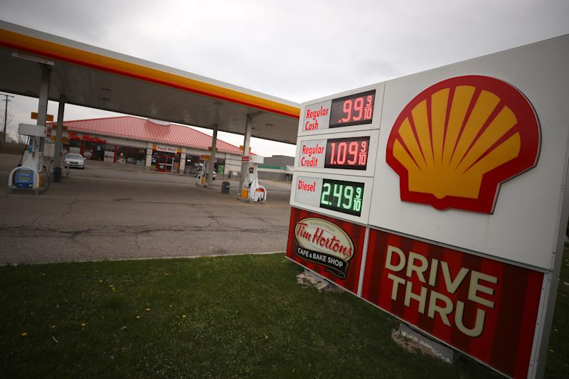 SOUTHGATE, MICHIGAN - APRIL 24: A Shell gas station is seen with a sign displaying gas for $ 0.99 per gallon on April 24, 2020 in Southgate, Michigan. With the demand of oil crashing due to restrictions from coronavirus gas prices across the country have plummeted with some areas seeing prices fall under a dollar a gallon. (Photo by Gregory Shamus/Getty Images)