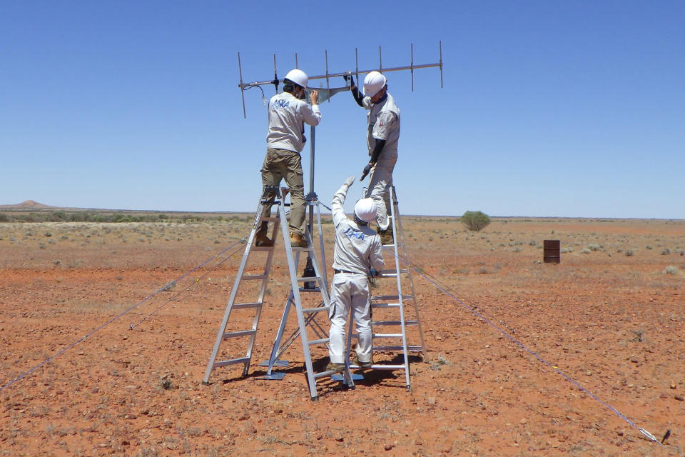 In this photo provided by JAXA, its crew members set up antenna in the preparation for the operation for the capsule collection in Woomera, South Australia in November, 2020. The Hayabusa2 spacecraft left the asteroid Ryugu, about 300 million kilometers (180 million miles) from Earth, a year ago and is expected to reach Earth and drop a capsule containing the precious samples in southern Australia on Dec. 6. (JAXA via AP)