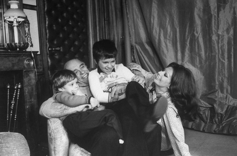 <p>Sophia Loren shares a laugh while spending a night at home with her husband, Carlo Ponti, and their two sons in 1976. </p>