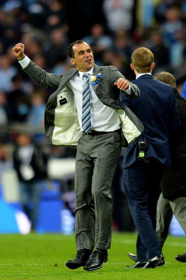 LONDON, ENGLAND - MAY 11: Manager Roberto Martinez of Wigan Athletic celebrates victory after the FA Cup with Budweiser Final between Manchester City and Wigan Athletic at Wembley Stadium on May 11, 2013 in London, England. (Photo by Shaun Botterill/Getty Images)