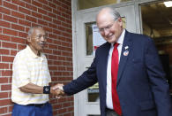 Former Mississippi Supreme Court Chief Justice Bill Waller Jr., right, shakes the hand of his Jackson, Miss., voting precinct bailiff Herbert Broome, Tuesday, Aug. 27, 2019, after voting at his Jackson, Miss., precinct. Waller is in a runoff race against Lt. Governor Tate Reeves for the GOP nomination for governor. (AP Photo/Rogelio V. Solis)