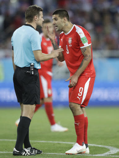 Referee Felix Brych from Germany admonishes Serbia's Aleksandar Mitrovic during the group E match between Switzerland and Serbia at the 2018 soccer World Cup in the Kaliningrad Stadium in Kaliningrad, Russia, Friday, June 22, 2018. (AP Photo/Matthias Schrader)