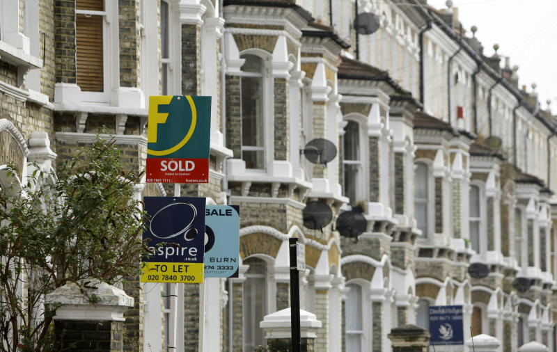 Estate agents' boards are seen in south London, Tuesday Feb. 17, 2009. British homeowners are returning to the property market looking to pick up bargains following recent house price falls, research showed Tuesday. (AP Photo/Matt Dunham)