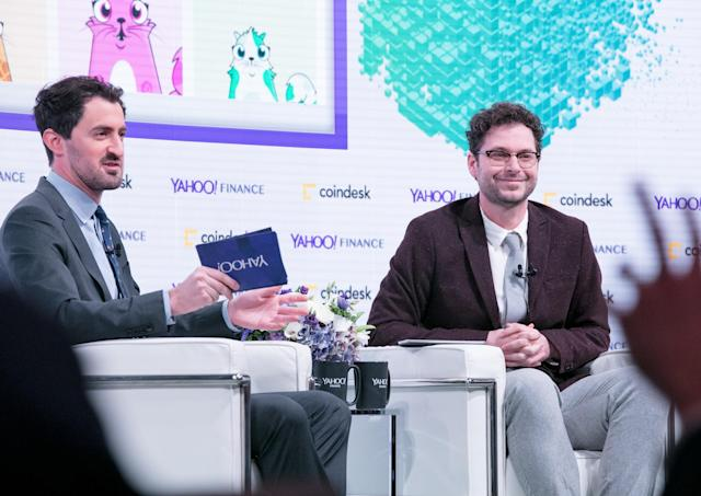CoinDesk research director Nolan Bauerle (R) speaks to Yahoo Finance's Dan Roberts at the Yahoo Finance All Markets Summit: Crypto on Feb. 7, 2018. The homepage of the Ethereum game CryptoKitties shows on screen. (Gino DePinto/Oath)