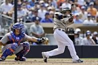 San Diego Padres' Alexi Amarista, right, drives a long sacrifice fly to center field against the New York Mets in the fifth inning of a baseball game on Sunday, Aug. 18, 2013, in San Diego. (AP Photo/Lenny Ignelzi)