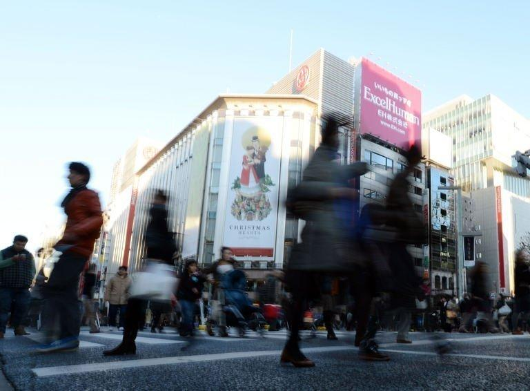 File photo of shoppers in the upmarket Ginza shopping district in Tokyo on December 1, 2012. The sound of Mandarin-speaking tourists and the cash tills they set ringing have become rare in Tokyo's upmarket Ginza district, retailers say, since a flare-up in an island row between China and Japan