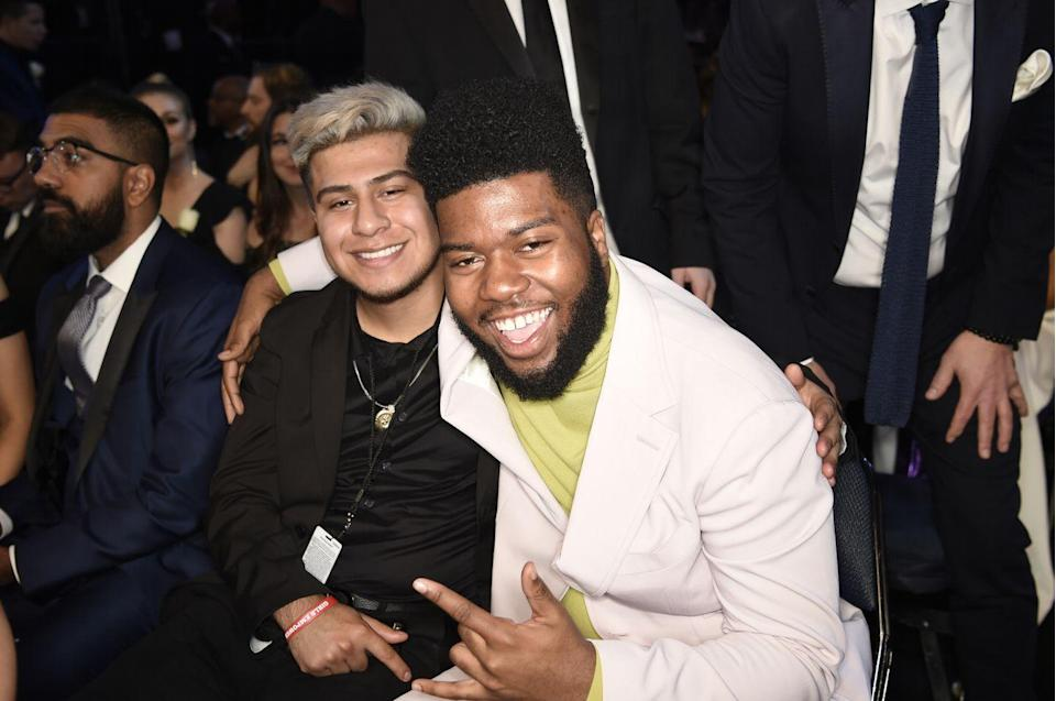 """<p>When Khalid attended the 60th Grammy Awards, he took his longtime best friend Carlos with him to the ceremony. While not much is known about the origins of their friendship (or even the last name of Carlos), their bond is clear. Following the awards in 2018, <a href=""""https://www.facebook.com/thegreatkhalid/posts/i-just-wanna-take-this-time-to-appreciate-the-best-friend-i-could-and-couldnt-ha/846094585597383/"""" rel=""""nofollow noopener"""" target=""""_blank"""" data-ylk=""""slk:Khalid wrote on Facebook"""" class=""""link rapid-noclick-resp"""">Khalid wrote on Facebook</a>, """"I just wanna take this time to appreciate the best friend I could and couldn't have ever asked for. Thank you Carlos, for all the endless support you give me man. When I'm down, you bring me up. When I lose my cool, you always know where to find it. When I was at one of the lowest points I've been, you sat next to me for a whole day in the same position. . .You're my brother for life man. That's my word.""""<br> </p>"""