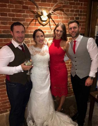 Jonathan Udall and Ellie Milward at their wedding with Becky Dobson and Stuart Hill.