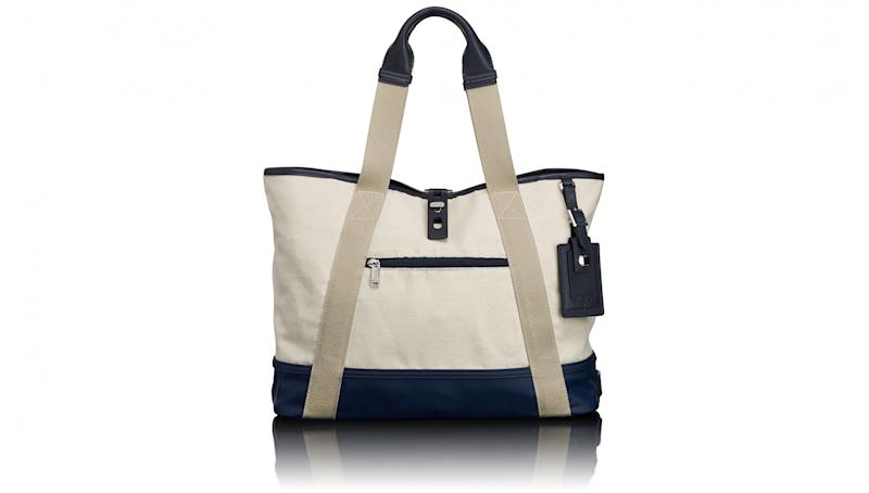 Upgrade your tired, go-to beach bag this season with a sleek and sturdy style from Tumi and Orlebar Brown. The two brands—the former known for its ultra-reliable travel cases and the latter for its precisely tailored and playfully patterned swim shirts—have teamed up for the first time to put a luxe twist on the classic canvas beach bag.