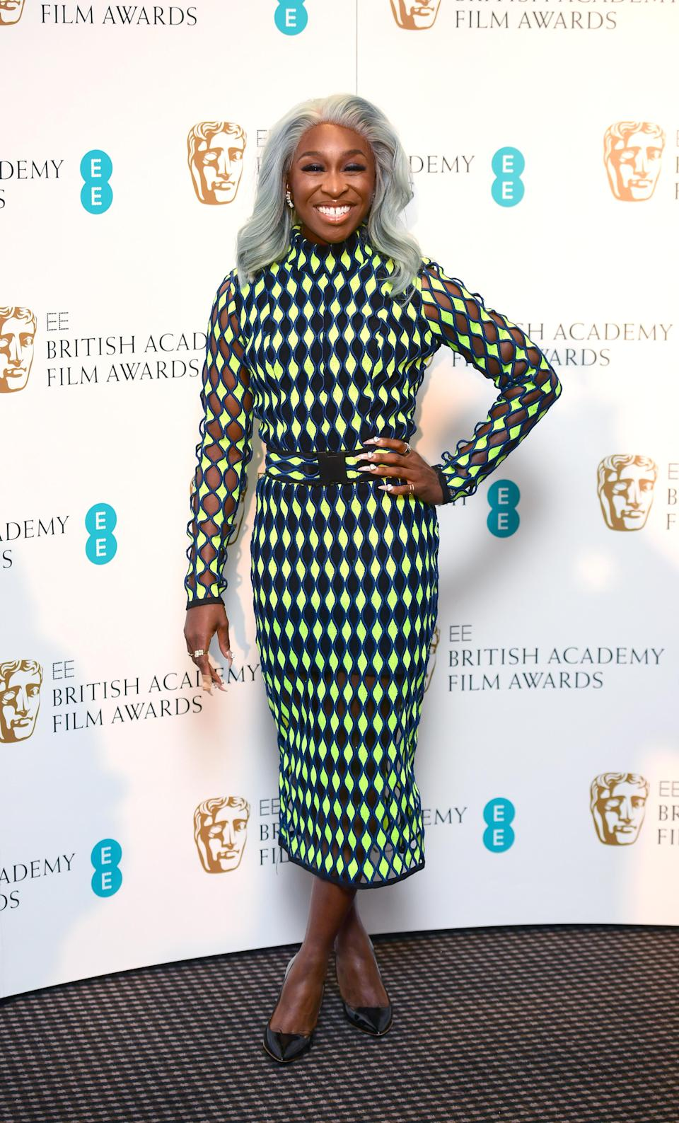 <p>On January 3, starlet Cynthia Erivo demonstrated how to wear neon hues this season in a seriously covetable midi dress. <em>[Photo: Getty]</em> </p>