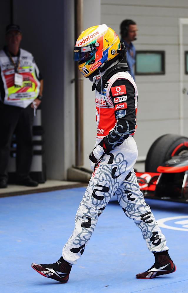 YEONGAM-GUN, SOUTH KOREA - OCTOBER 15: Lewis Hamilton of Great Britain and McLaren reacts in parc ferme after finishing first during qualifying for the Korean Formula One Grand Prix at the Korea International Circuit on October 15, 2011 in Yeongam-gun, South Korea. (Photo by Mark Thompson/Getty Images)