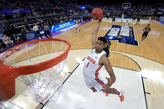 "<span class=""element-image__caption"">Florida's Devin Robinson soars to the rim during Thursday's first-round game.</span> <span class=""element-image__credit"">Photograph: Mike Ehrmann/Getty Images</span>"